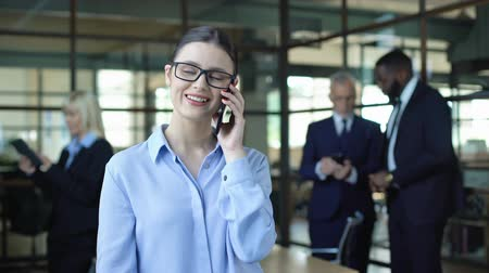 рекламный : Smiling business woman talking on phone during work break, mobile conversation