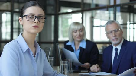 прокат : Smart woman in glasses looking into camera, apprentice starts successful career