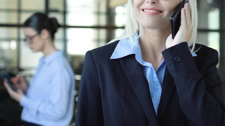 телефон доверия : Lady in suit listening client on phone, consulting services, business solutions Стоковые видеозаписи