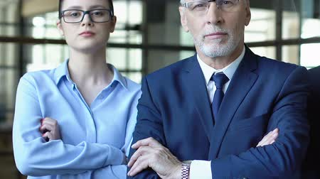 official : Business people with crossed arms, team of professionals giving success advice Stock Footage