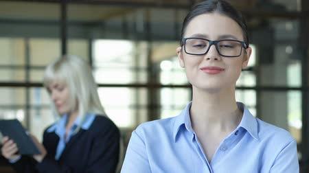 прокат : Intelligent woman in glasses posing on camera, employment of young professionals