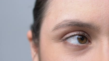 neuritis : Woman rolling her red overworked eyes irritated with job, face close-up