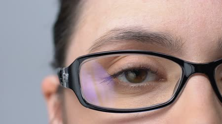 neuritis : Woman in glasses blinking, tired of bad vision, eyesight problems, close-up