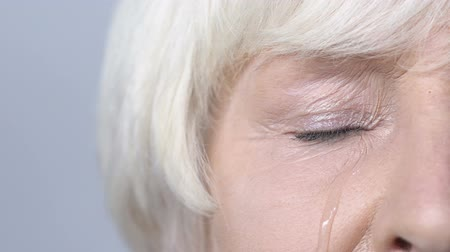 시력 : Depressed aged woman crying, tears on her cheek, problems with health, pain