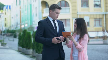 un : Busy male millionaire rejecting female fan asking for autograph on street