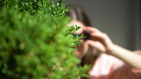 magánélet : Jealous woman with binoculars hiding behind tree spying for husband, betrayal