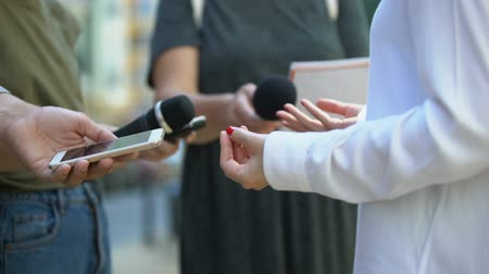 election campaign : Woman gesticulating during interview with media, press conference, close-up Stock Footage