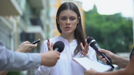refusing : Angry female celebrity talking with annoyed journalists searching for sensation