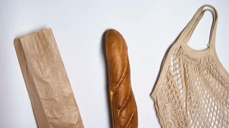 stop motion : Paper package refusing in favor of reusable eco bag for bread, ecology saving