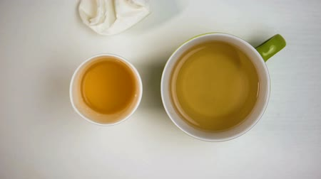 вред : Ceramic and paper tea cups on table, benefit of reusable drink material, ecology Стоковые видеозаписи