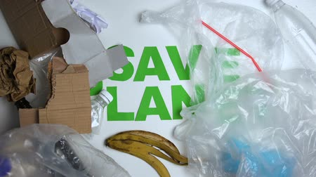 world cup : Garbage lying around save planet phrase against white background ecology concept Stock Footage