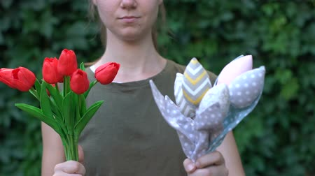 sentetik : Female proposing fabric bouquet of flowers instead bunch of fresh tulips, nature Stok Video