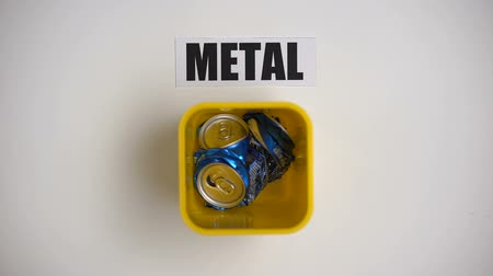 kutuları : Metal word written near container with cans, collecting reusable garbage recycle
