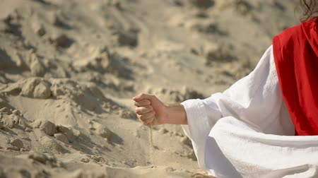 philosopher : Male hand in robe pouring sand, symbol of passing life, time is running out Stock Footage