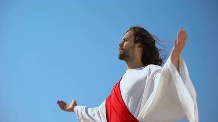 jezus : Saint man looking at sky with opened hands, Jesus resurrection and ascension