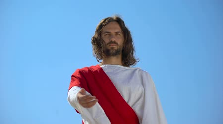 invite : Jesus stretching arm to camera, forgiving sinners, helping hand and charity Stock Footage