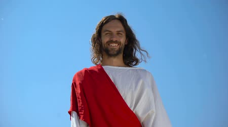 священник : Cheerful god Jesus laughing into camera from heaven, concept to enjoy life