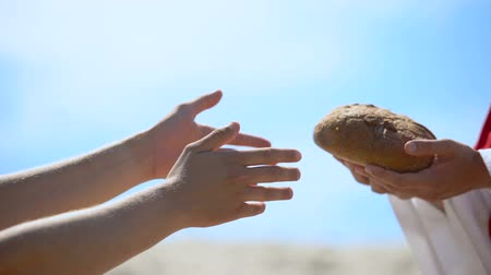 biblia : Jesus hands giving bread to poor man, biblical story to feed hungry, charity