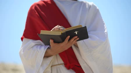 holy scripture : Prophet in robe reading bible, theology and interpretation of Christianity Stock Footage