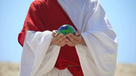ekosistem : Jesus holding Earth planet, love for world and self-sacrifice, nature saving