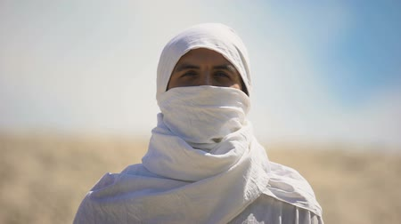 the bedouin : Bedouin in white clothes looking on camera, islamic religion and traditions