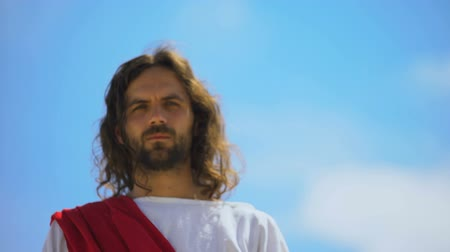fiel : Jesus approaching to camera, looking with mercy, forgiving sins, bottom view Stock Footage