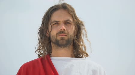 tür : Jesus crying and looking into camera, feeling compassion for people, mercy Stok Video