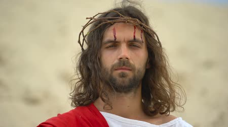 crucified : Drops of blood running down Jesus face, God looking on camera, crucifixion Stock Footage