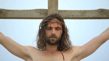 crucified : Jesus suffering and dying nailed to cross, ultimate sacrifice, saving people