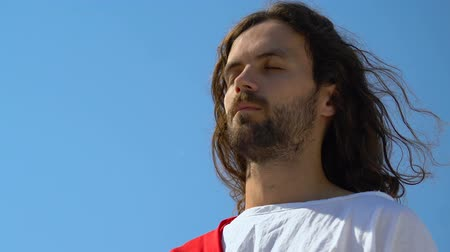 pap : Jesus with eyes closed meditating outdoors, praying for saving people souls