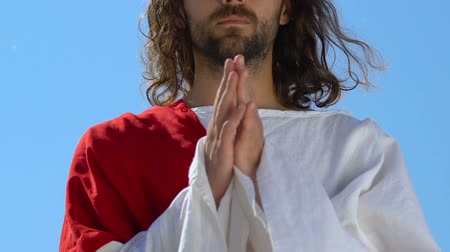sinner : Apostle in white robe praying God against sky background, spirituality, close-up Stock Footage