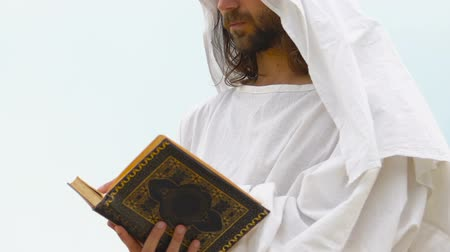 fiel : Muslim reading Quran praying to exploring holy Islamic teaching, theology