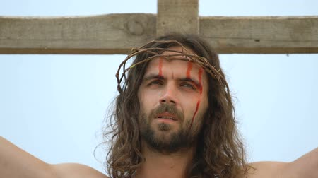 crucifix : Crucified Jesus in thorn crown praying God Father in sky, atoning sacrifice Stock Footage
