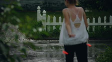 скрывать : Woman running home fast because of rainy weather, trying to hide from rain