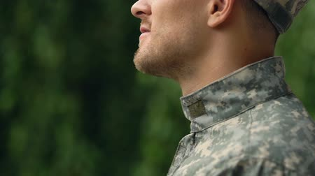 homecoming : Young serviceman in uniform outdoors, enjoying rest in park, homecoming relax Stock Footage