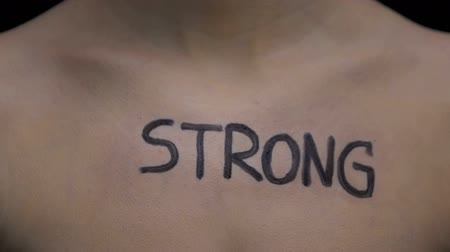 abuse : Strong written on female body, confident woman discovering power, discrimination Stock Footage