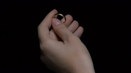halkalar : Female holding gold wedding ring in hand closeup, memory of marriage, divorce Stok Video