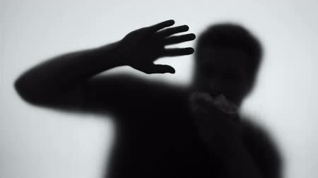 damp : Gas attack victim coughing and covering mouth, chemical weapon danger, pollution
