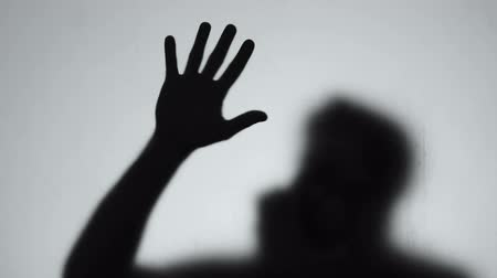 damp : Male shadow protective mask suffering gas poisoning, biological weapon radiation Stockvideo