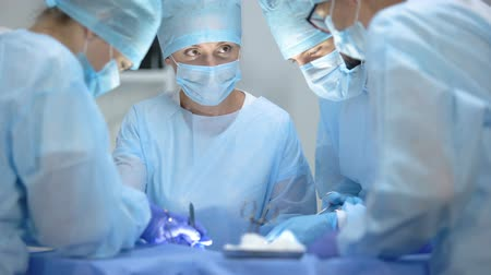 invasive : Serious surgeon team performing cardiothoracic surgery, hospital operation
