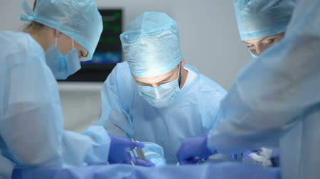 invasive : Nervous surgeons performing operation in hospital with modern equipment, work Stock Footage