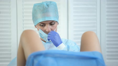 respiração : Professional gynecologist taking womans cervix sample during examination