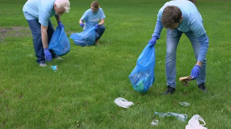 forest preservation : Volunteers collecting garbage in park, healthy ecosystem, resource conservation