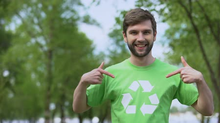 preservation : Young environmental activist pointing at recycling symbol t-shirt, segregation