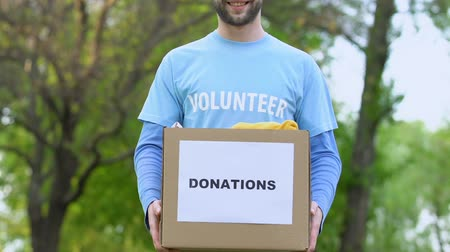 philanthropy : Bearded male volunteer holding donation box, philanthropy social charity project Stock Footage