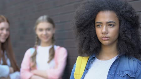 multikulturális : Teenagers mocking insecure biracial girl, gossiping about new classmate bullying