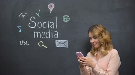 targeting : Girl posting message in social media using cell phone, global connection in net