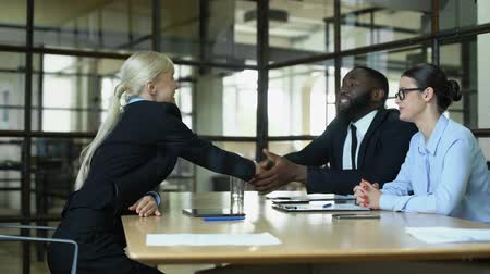 sallama : Blond business woman shaking partners hands, greeting in office, profession