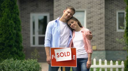 проданный : Beautiful couple hugging and smiling on background of luxury house, investment Стоковые видеозаписи