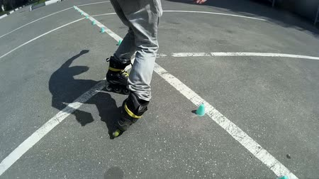 roller blading : active sports theme footage. Rollerblade Freestyle Slalom